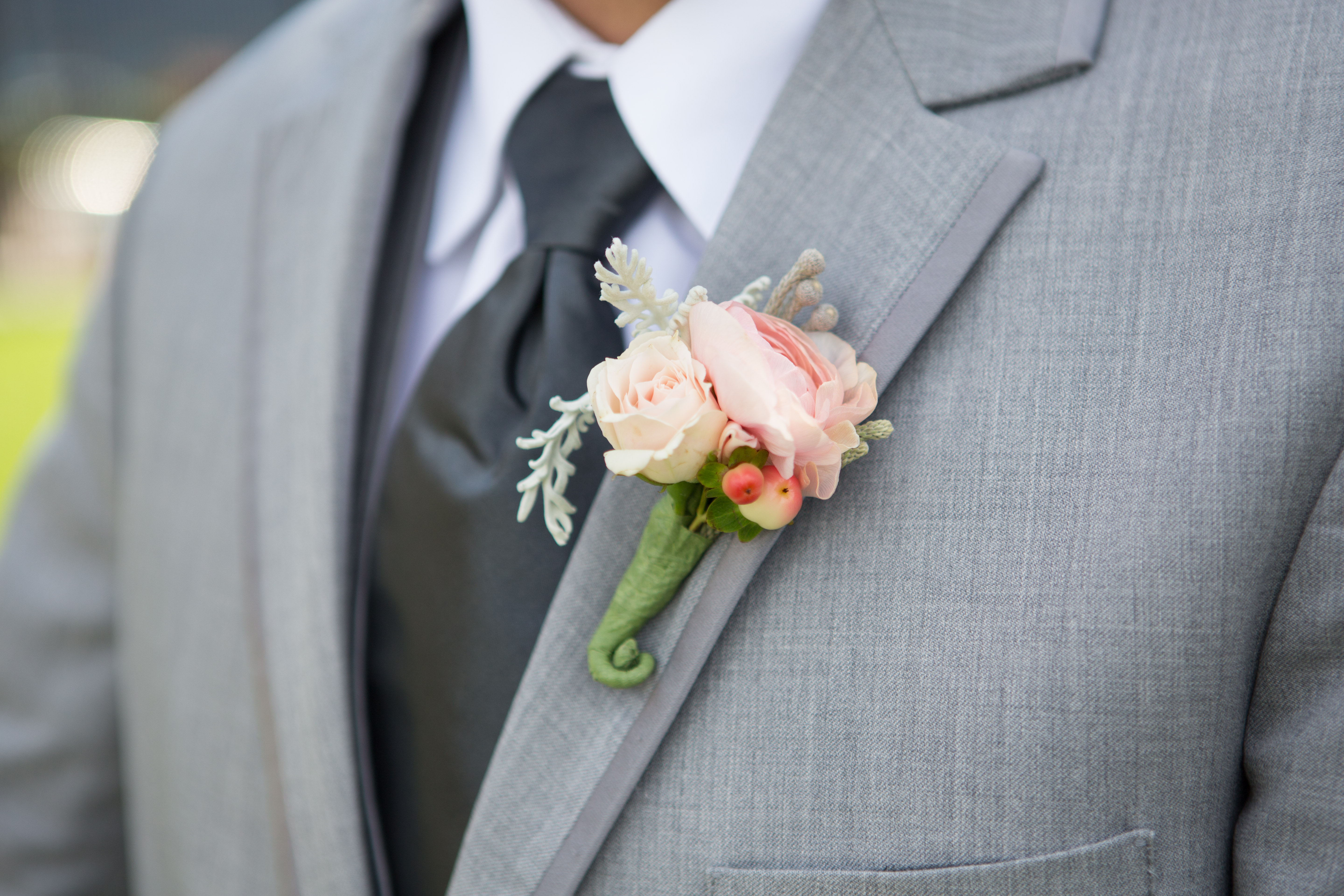 Grooms boutonniere- soft pink ranunculus, spray rose and gray ...