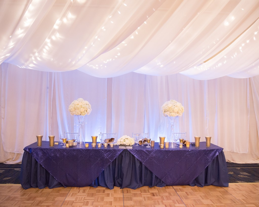 White ceiling event draping, and backdrop, navy blue linens, white flowers, florist, Campbells Resort, Lake Chelan Flowers, Rogue Heart Media, Lake Chelan Wedding Rentals
