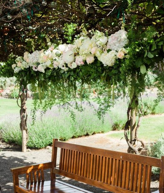 custom-built-floral-canopy-white-blush-ivory-florist-hanging-foliage-lakechelanflowers-com-heathermayerphotography-lakechelanweddingrentals-com-caveb-com